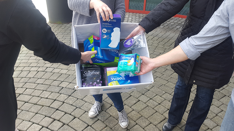 people donating menstruation products on Tampon Tuesday