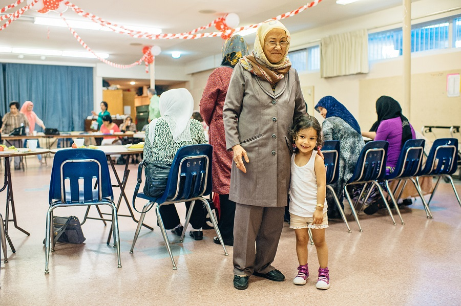 picture of a grandma with her granddaughter at a seniors program