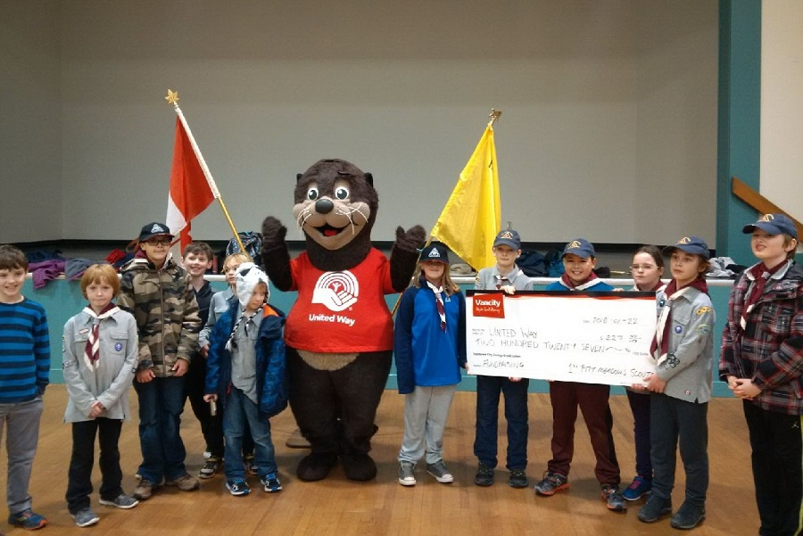 scouts presenting a cheque.