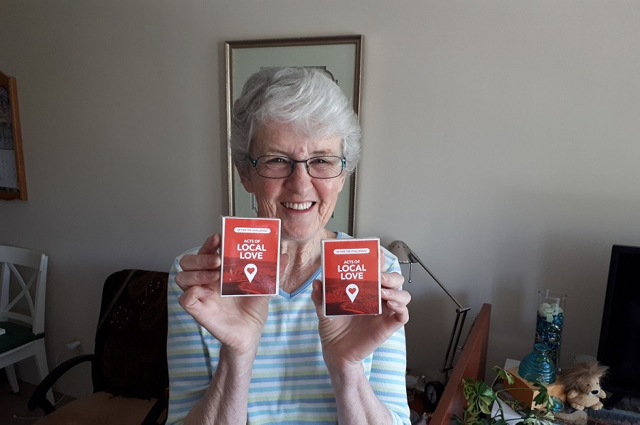 woman holding two card decks