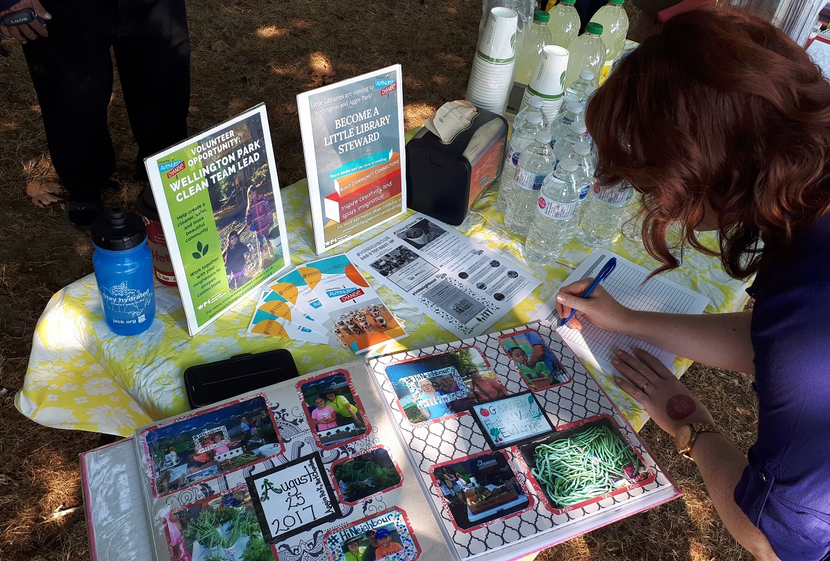 A scrapbook and pamphlets on a table.
