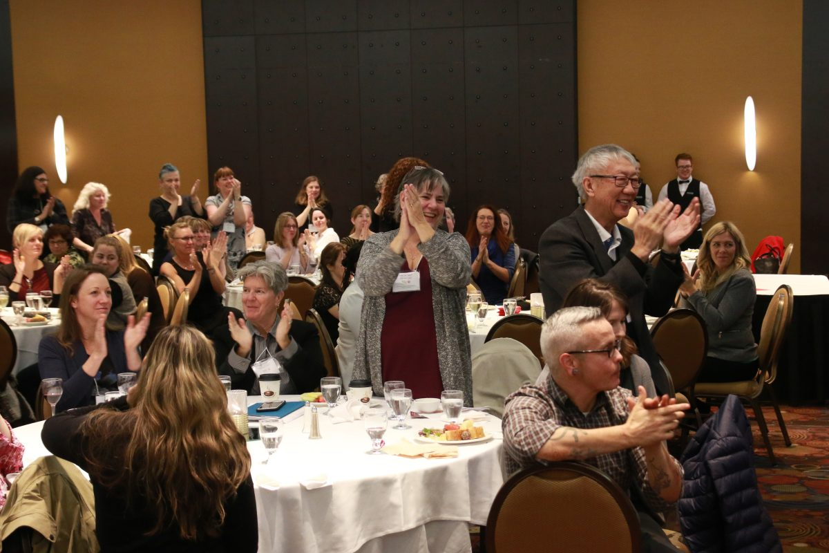 participants applaud at the provincial summit on aging 2017