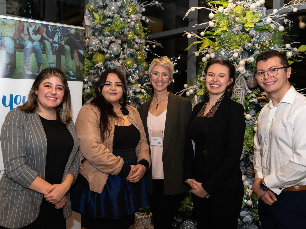 students with maureen young at yfef event